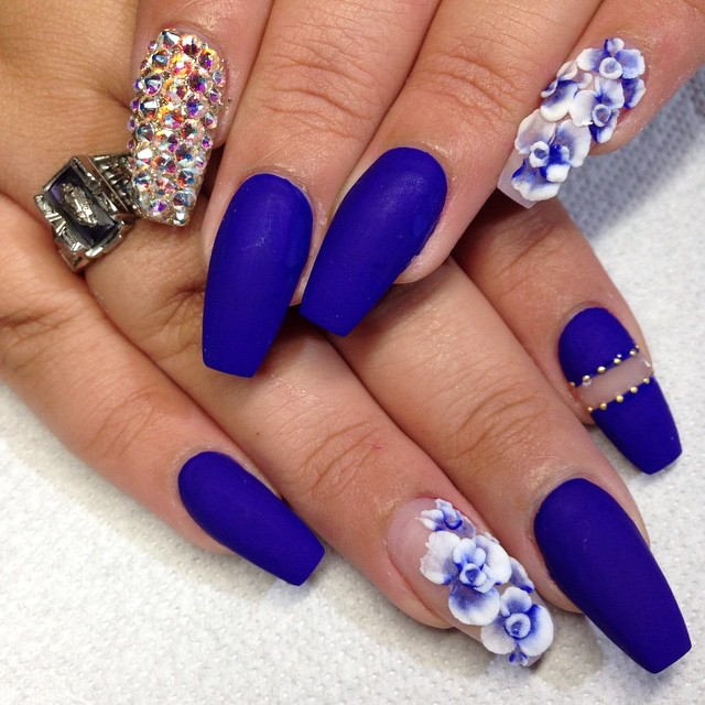 Blue Nails with Flowers and Gems via