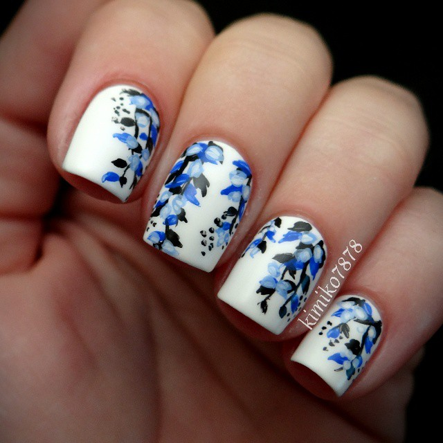 White Nails with Blue Flowers via