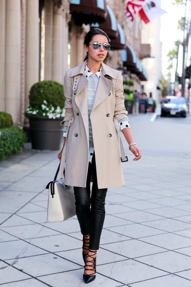 beige-trench-coat-striped-top-and-black-tights via
