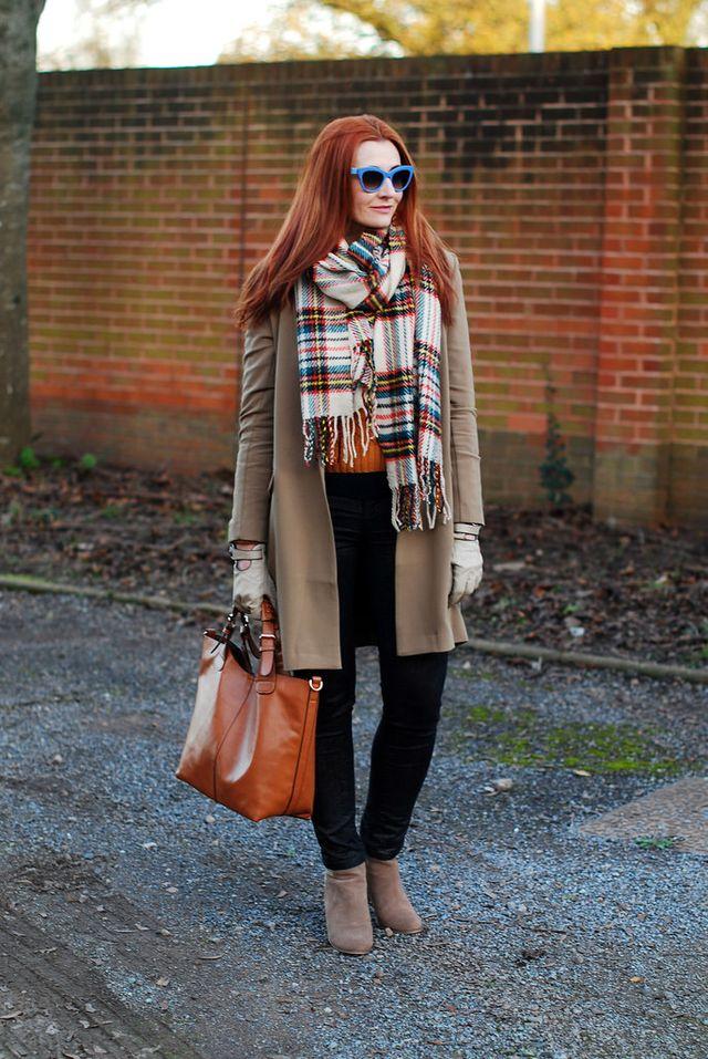 camel-trench-orange-sweater-black-pants-and-tartan-scarf via