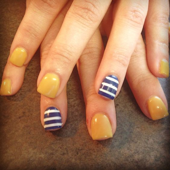 mustard-nails-with-blue-and-white-lines via