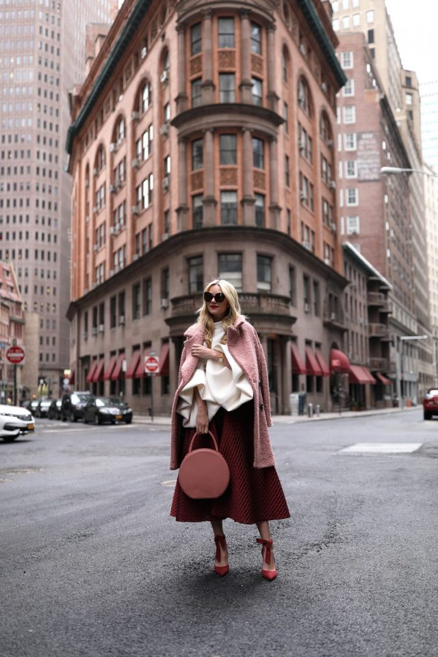 pink-coat-white-top-and-red-skirt via